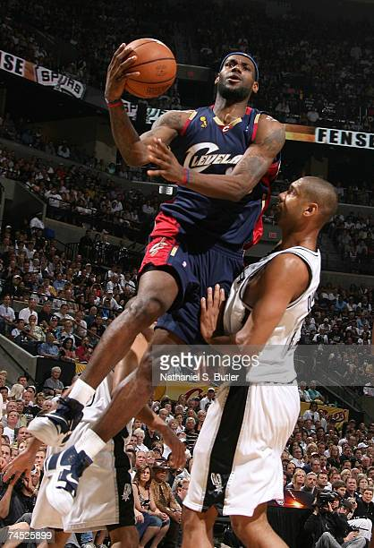 LeBron James of the Cleveland Cavaliers drives for a shot attempt against Tim Duncan of the San Antonio Spurs in Game Two of the NBA Finals at the...