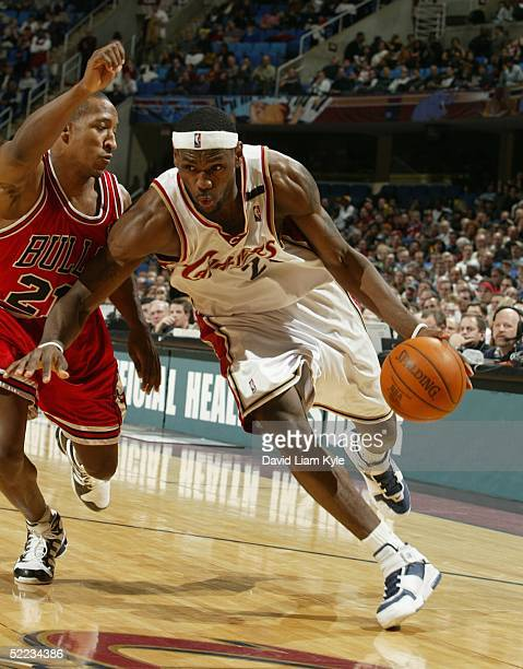 LeBron James of the Cleveland Cavaliers drives inside on on Chris Duhon of the Chicago Bulls on February 23, 2005 at Gund Arena in Cleveland, Ohio....