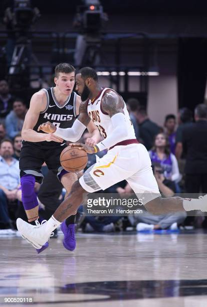 LeBron James of the Cleveland Cavaliers drives on Bogdan Bogdanovic of the Sacramento Kings during their NBA basketball game at Golden 1 Center on...