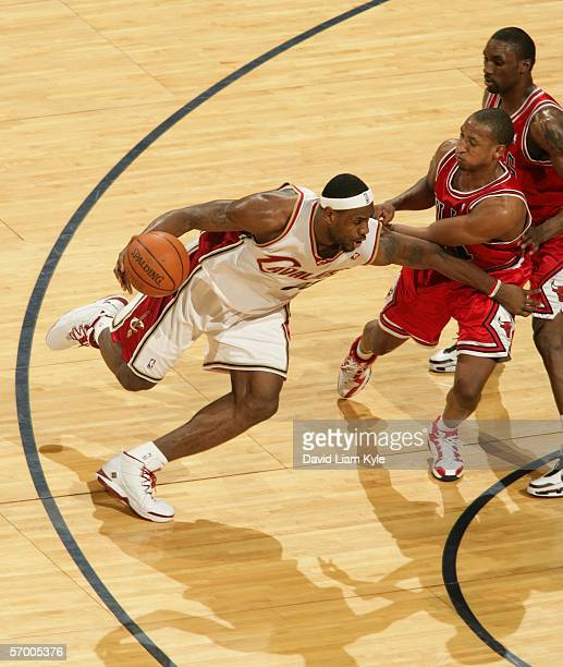LeBron James of the Cleveland Cavaliers drives past Chris Duhon of the Chicago Bulls March 5 2006 at The Quicken Loans Arena in Cleveland Ohio NOTE...