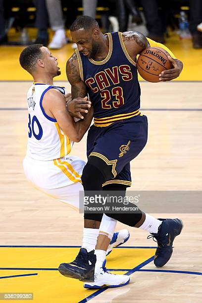 LeBron James of the Cleveland Cavaliers drives through Stephen Curry of the Golden State Warriors in Game 2 of the 2016 NBA Finals at ORACLE Arena on...