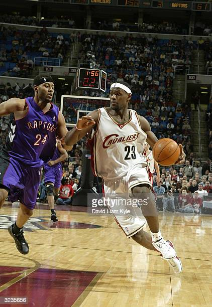 LeBron James of the Cleveland Cavaliers drives to the basket against the Toronto Raptors at Gund Arena on April 6, 2004 in Cleveland, Ohio. NOTE TO...