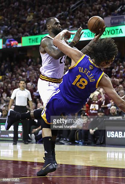LeBron James of the Cleveland Cavaliers drives to the basket against Anderson Varejao of the Golden State Warriors during the second half in Game 3...