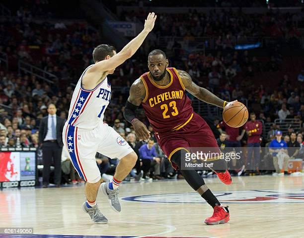 LeBron James of the Cleveland Cavaliers drives to the basket against TJ McConnell of the Philadelphia 76ers in the fourth quarter at Wells Fargo...