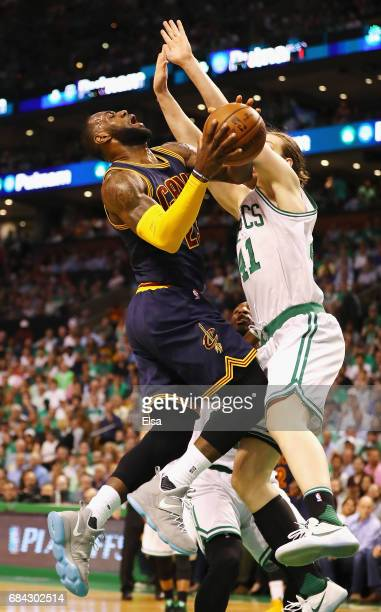 LeBron James of the Cleveland Cavaliers drives to the basket against Kelly Olynyk of the Boston Celtics in the first half during Game One of the 2017...
