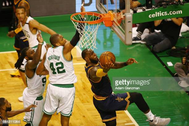 LeBron James of the Cleveland Cavaliers drives to the basket against Al Horford of the Boston Celtics in the first half during Game One of the 2017...