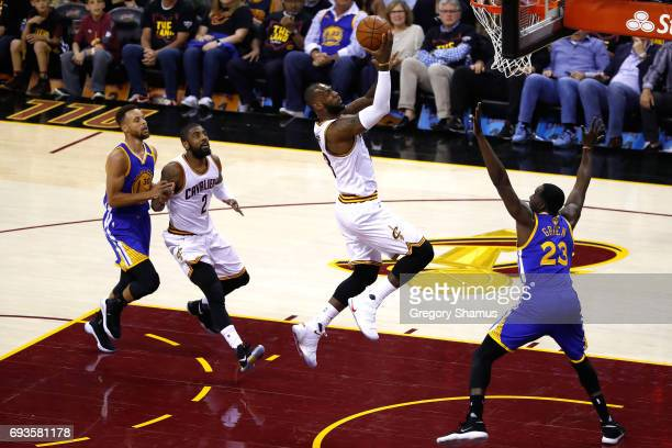 LeBron James of the Cleveland Cavaliers drives to the basket against Draymond Green of the Golden State Warriors in the first quarter in Game 3 of...