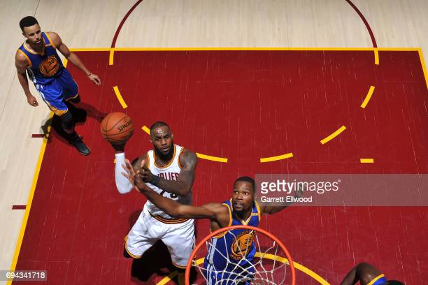 LeBron James of the Cleveland Cavaliers drives to the basket against Kevin Durant of the Golden State Warriors in Game Four of the 2017 NBA Finals on...