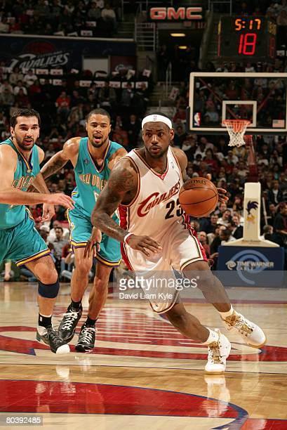 LeBron James of the Cleveland Cavaliers drives to the basket against Peja Stojakovic and Tyson Chandler of the New Orleans Hornets on March 26, 2008...