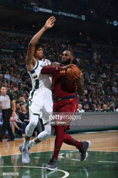 LeBron James of the Cleveland Cavaliers drives to the basket against Giannis Antetokounmpo of the Milwaukee Bucks on October 20 2017 at the BMO...