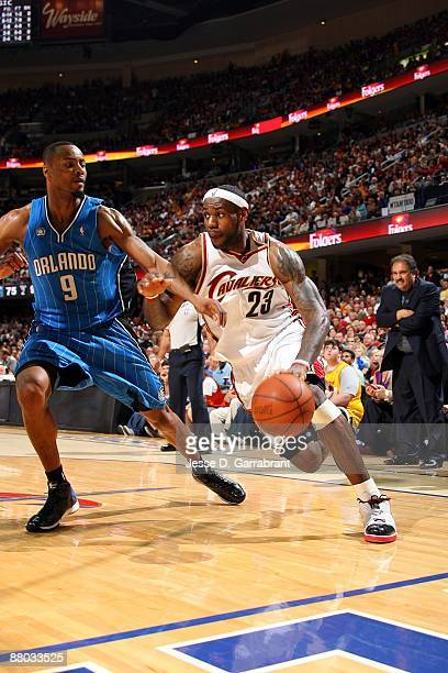 LeBron James of the Cleveland Cavaliers drives to the basket against Rashard Lewis of the Orlando Magic in Game Two of the Eastern Conference Finals...