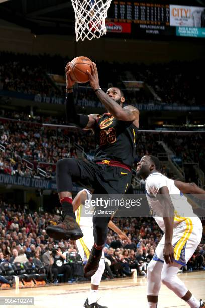 LeBron James of the Cleveland Cavaliers drives to the basket against the Golden State Warriors on January 15 2018 at Quicken Loans Arena in Cleveland...