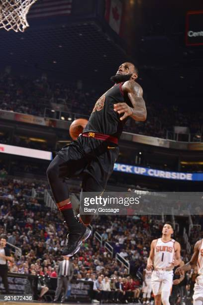 LeBron James of the Cleveland Cavaliers drives to the basket against the Phoenix Suns on March 13 2018 at Talking Stick Resort Arena in Phoenix...