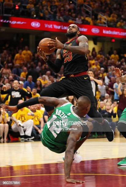 LeBron James of the Cleveland Cavaliers drives to the basket against Terry Rozier of the Boston Celtics in the first half during Game Three of the...