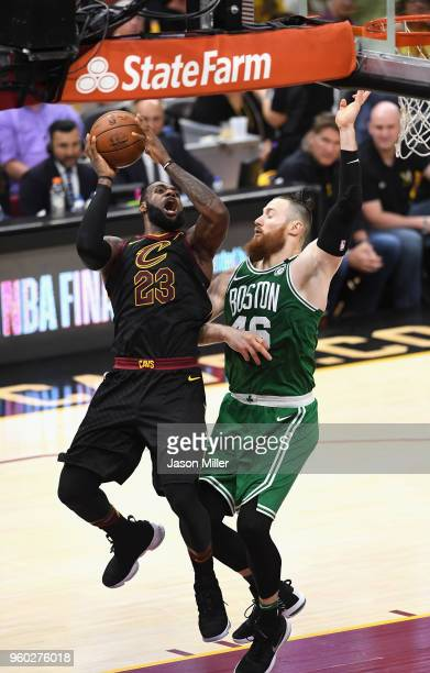 LeBron James of the Cleveland Cavaliers drives to the basket against Aron Baynes of the Boston Celtics in the second half during Game Three of the...