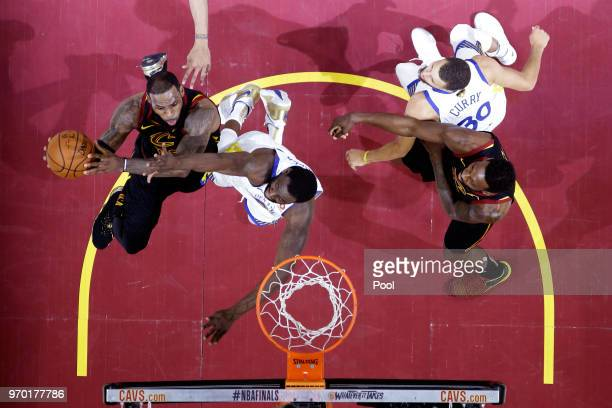 LeBron James of the Cleveland Cavaliers drives to the basket against Draymond Green of the Golden State Warriors in the first half during Game Four...