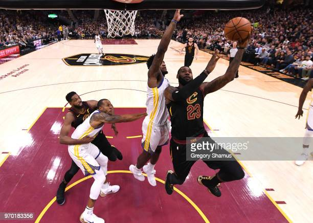 LeBron James of the Cleveland Cavaliers drives to the basket against Jordan Bell of the Golden State Warriors in the first half during Game Four of...