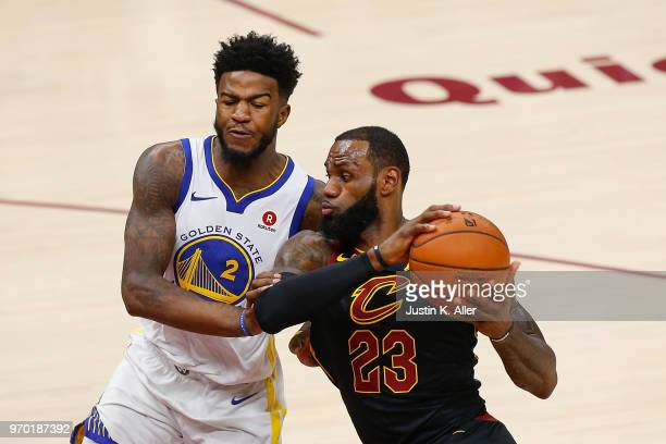LeBron James of the Cleveland Cavaliers drives to the basket defended by Jordan Bell of the Golden State Warriors during Game Four of the 2018 NBA...