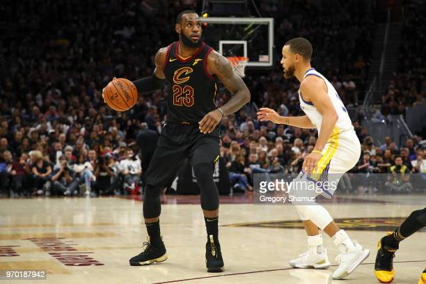 LeBron James of the Cleveland Cavaliers drives to the basket defended by Stephen Curry of the Golden State Warriors during Game Four of the 2018 NBA...