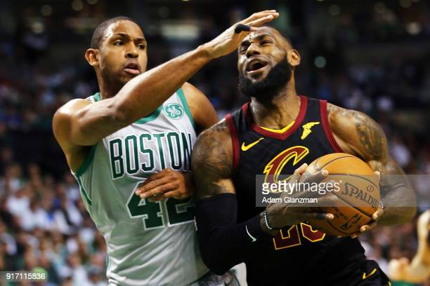 Lebron James of the Cleveland Cavaliers drives to the basket during a game against the Boston Celtics at TD Garden on February 11 2018 in Boston...