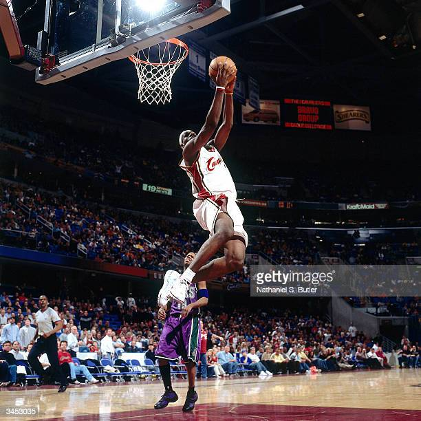 LeBron James of the Cleveland Cavaliers drives to the basket for a reverse dunk against the Milwaukee Bucks on April 12, 2004 at the Gund Arena in...