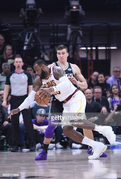 LeBron James of the Cleveland Cavaliers drives to the basket on Bogdan Bogdanovic of the Sacramento Kings during their NBA basketball game at Golden...