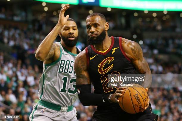 Lebron James of the Cleveland Cavaliers drives to the basket past Marcus Morris of the Boston Celtics during the first quarter of a game at TD Garden...