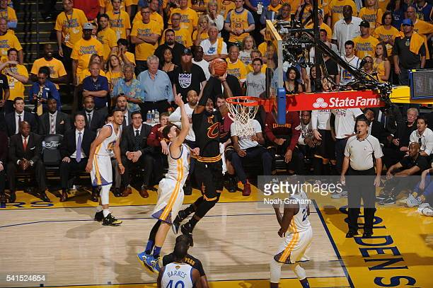 LeBron James of the Cleveland Cavaliers dunks against Golden State Warriors in Game Seven of the 2016 NBA Finals on June 19 2016 at ORACLE Arena in...