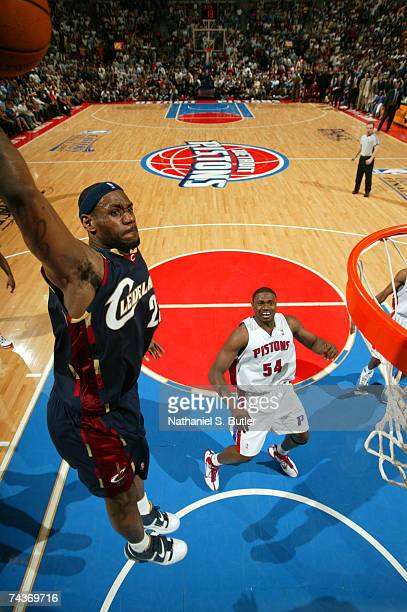 LeBron James of the Cleveland Cavaliers dunks against Jason Maxiell of the Detroit Pistons in Game Five of the Eastern Conference Finals during the...