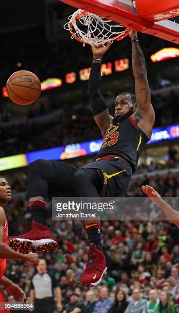LeBron James of the Cleveland Cavaliers dunks against the Chicago Bulls at the United Center on March 17 2018 in Chicago Illinois NOTE TO USER User...