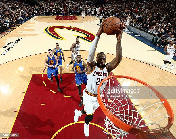 LeBron James of the Cleveland Cavaliers dunks against the Golden State Warriors in Game Six of the 2016 NBA Finals on June 16 2016 at Quicken Loans...