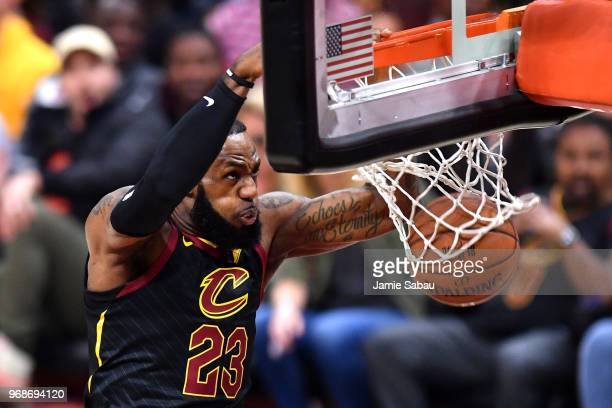 LeBron James of the Cleveland Cavaliers dunks against the Golden State Warriors in the first quarter during Game Three of the 2018 NBA Finals at...