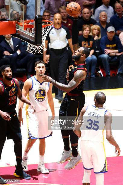 LeBron James of the Cleveland Cavaliers dunks against the Golden State Warriors in the second half during Game Three of the 2018 NBA Finals at...