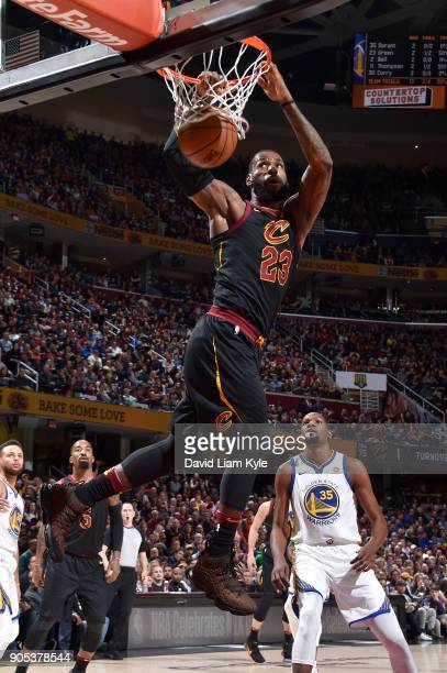 LeBron James of the Cleveland Cavaliers dunks against the Golden State Warriors on January 15 2018 at Quicken Loans Arena in Cleveland Ohio NOTE TO...