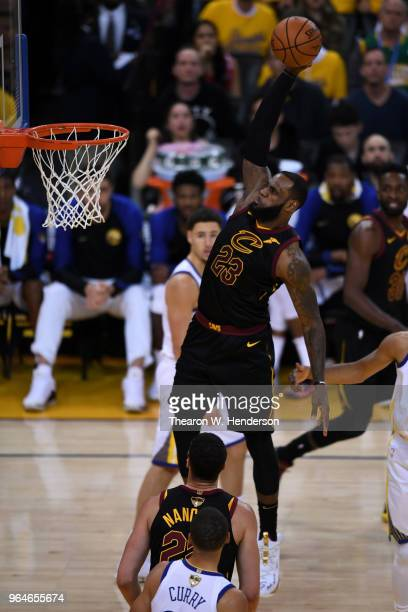 LeBron James of the Cleveland Cavaliers dunks against the Golden State Warriors during the second half in Game 1 of the 2018 NBA Finals at ORACLE...