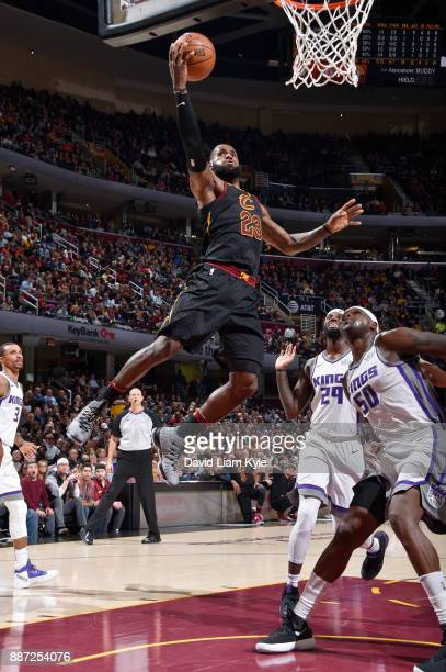 LeBron James of the Cleveland Cavaliers dunks against the Sacramento Kings on December 6 2017 at Quicken Loans Arena in Cleveland Ohio NOTE TO USER...