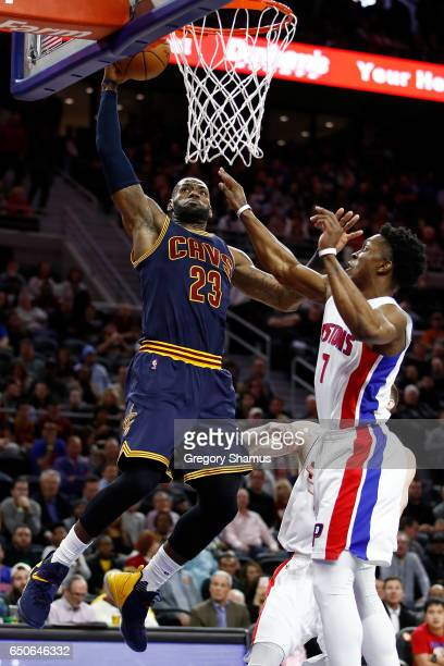 LeBron James of the Cleveland Cavaliers dunks behind Stanley Johnson of the Detroit Pistons during the first half at the Palace of Auburn Hills on...