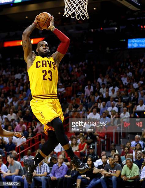 LeBron James Of The Cleveland Cavaliers Dunks During A Game Against Miami Heat At American
