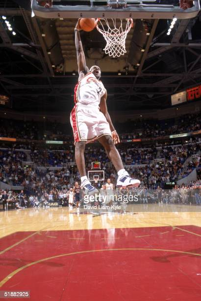 LeBron James of the Cleveland Cavaliers dunks during a game against the New Jersey Nets at Gund Arena on December 7 2004 in Cleveland Ohio The Cavs...