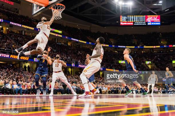 LeBron James of the Cleveland Cavaliers dunks during the first half against the Utah Jazz at Quicken Loans Arena on December 16 2017 in Cleveland...