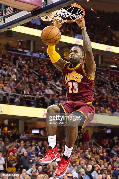 LeBron James of the Cleveland Cavaliers dunks during the second half against the Miami Heat at Quicken Loans Arena on October 30 2015 in Cleveland...
