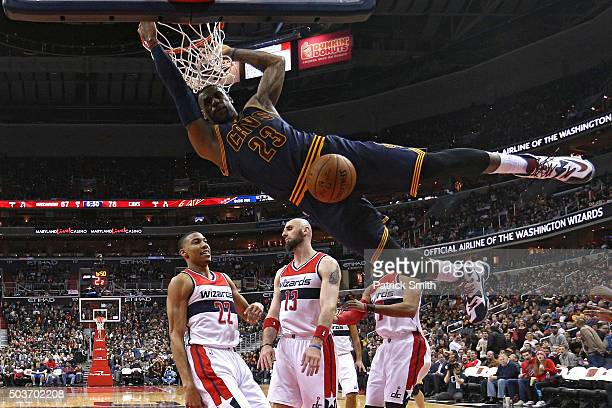 LeBron James of the Cleveland Cavaliers dunks in front of Otto Porter Jr #22 of the Washington Wizards and teammates during the second half at...