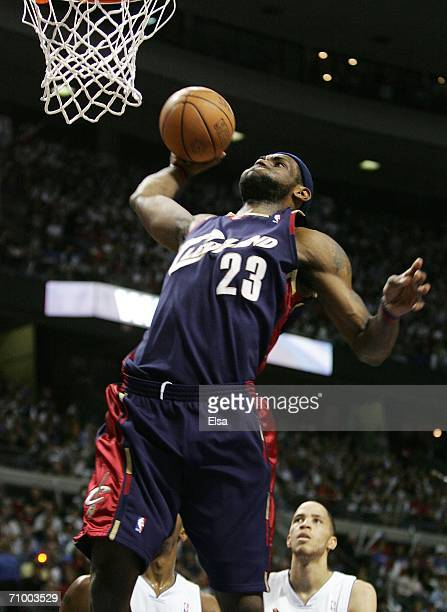 LeBron James of the Cleveland Cavaliers dunks in the first half against the Detroit Pistons in game seven of the Eastern Conference Semifinals during...
