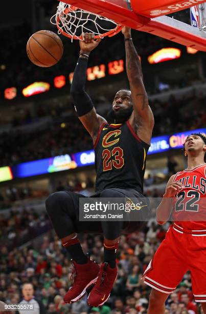 LeBron James of the Cleveland Cavaliers dunks over Cameron Payne of the Chicago Bulls at the United Center on March 17 2018 in Chicago Illinois NOTE...