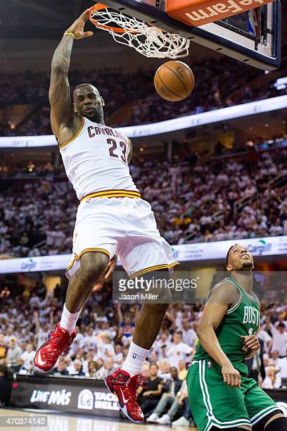 LeBron James of the Cleveland Cavaliers dunks over Evan Turner of the Boston Celtics in the first half during Game One in the Eastern Conference...