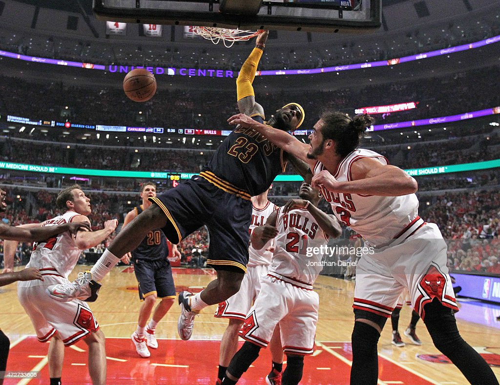 LeBron James #23 of the Cleveland Cavaliers dunks over (l-R) Mike Dunleavy #34, Jimmy Buter #21 and Joakim Noah #13 of the Chicago Bulls in Game Three of the Eastern Conference Semifinals of the 2015 NBA Playoffs at the United Center on May 8, 2015 in Chicago, Illinois. The Bulls defeated the Cavaliers 99-96.