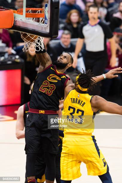 LeBron James of the Cleveland Cavaliers dunks over Myles Turner of the Indiana Pacers during the first half of Game 2 of the first round of the...