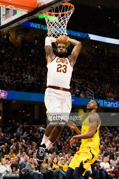 LeBron James of the Cleveland Cavaliers dunks over Thaddeus Young of the Indiana Pacers during the second half at Quicken Loans Arena on January 26...