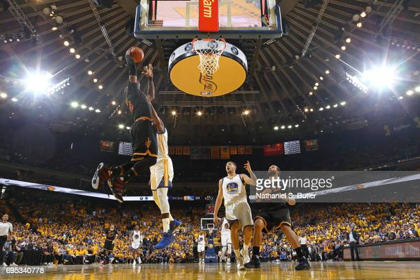 LeBron James of the Cleveland Cavaliers dunks the ball against Kevin Durant of the Golden State Warriors in Game Five of the 2017 NBA Finals on June...