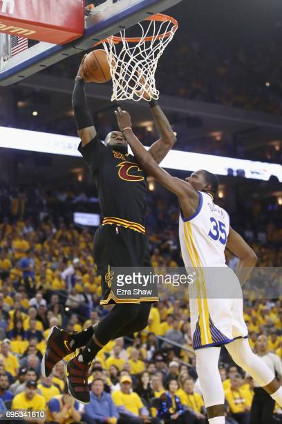 LeBron James of the Cleveland Cavaliers dunks the ball against Kevin Durant of the Golden State Warriors in Game 5 of the 2017 NBA Finals at ORACLE...